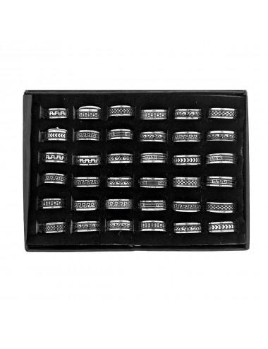 5300014 - Caja con 36 anillos de acero dibujos negros