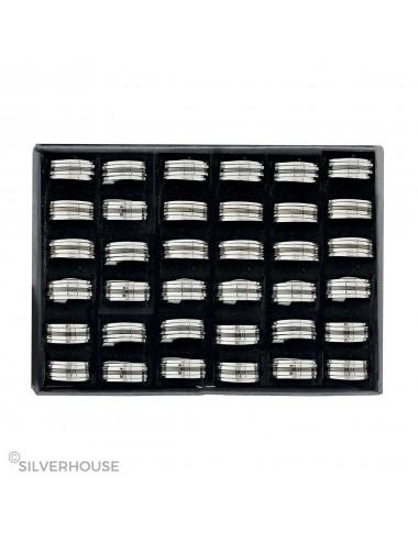 5300030 - Caja con 36 anillos de acero anti estrés con línea negra